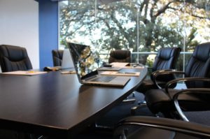 boardroom with chairs and laptop